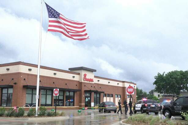 Houston police investigate a deadly shooting at a Chick-Fil-A in the 100 block of West Road on Thursday, April 9, 2020.