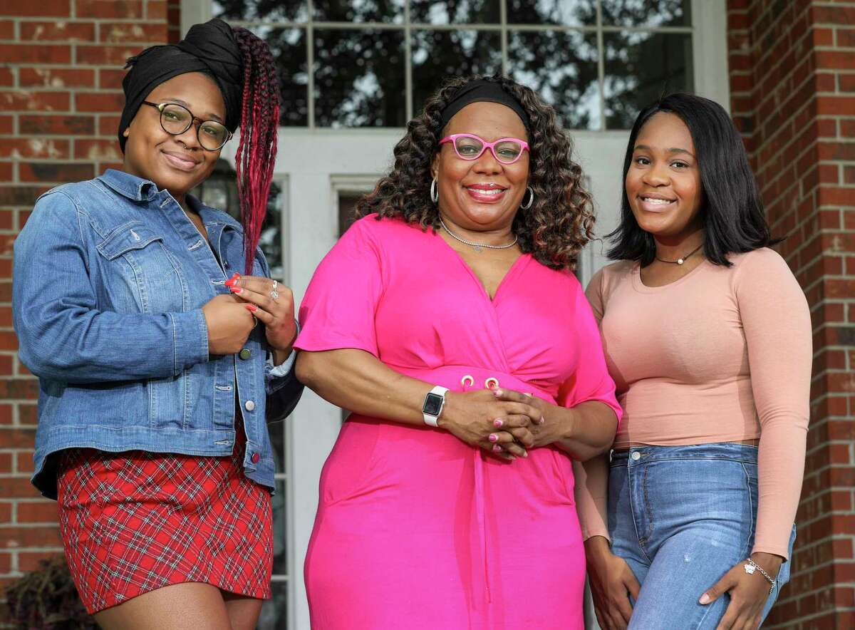 Acclaimed author ReShonda Tate Billingsley, center, and her daughters Mya, left, and Morgan, right, are experimenting with different ways to do their hair while social distancing at home.