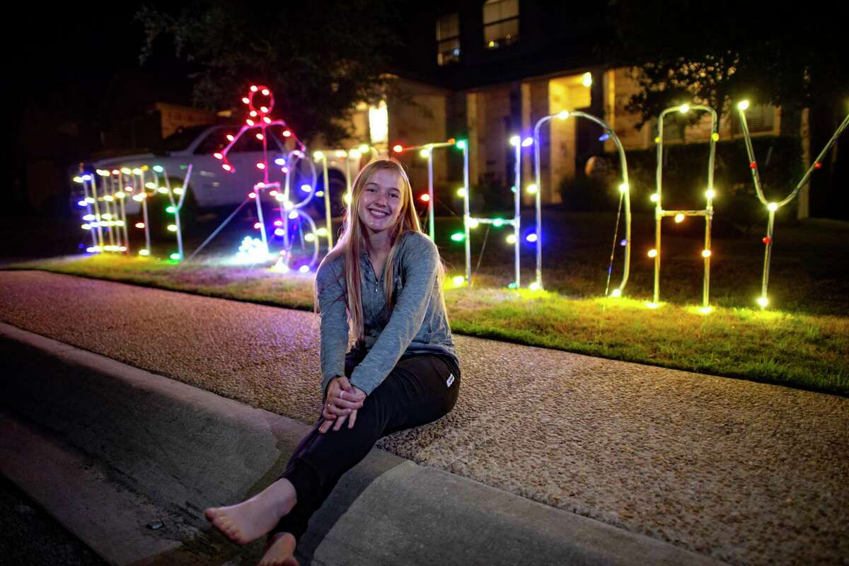 Samantha Maudsley, 18, a senior at Reagan High School, sits by a lighted birthday sign created by Heather and Hunter Hinson-Heart, owners of Hinson Home Services/Hinson Home for Christmas, on Wednesday, April 8, 2020. Samantha, a player on the soccer team, was coming off of an injury and had just scored for the first time this season when the coronavirus pandemic forced schools to close.
