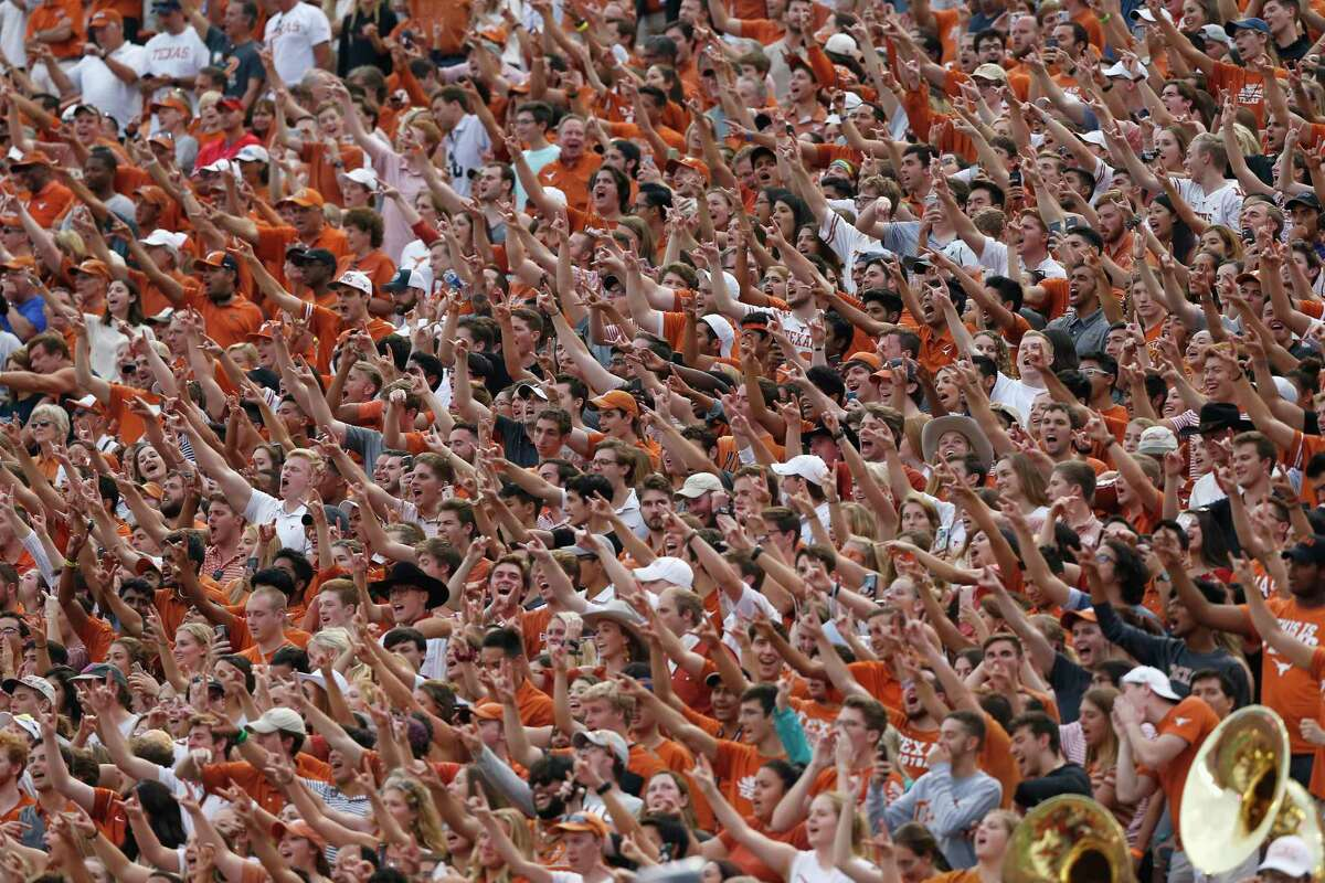 Texas Longhorns fans cheer in the second half against the TCU Horned Frogs at Darrell K Royal-Texas Memorial Stadium on September 22, 2018. The university announced this week that 13 football players had tested positive for the coronavirus.