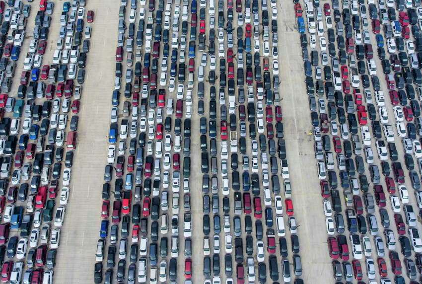 People wait in their cars for a San Antonio Food Bank to begin food distribution. Click through to see more photos that have defined the COVID-19 pandemic in San Antonio >>