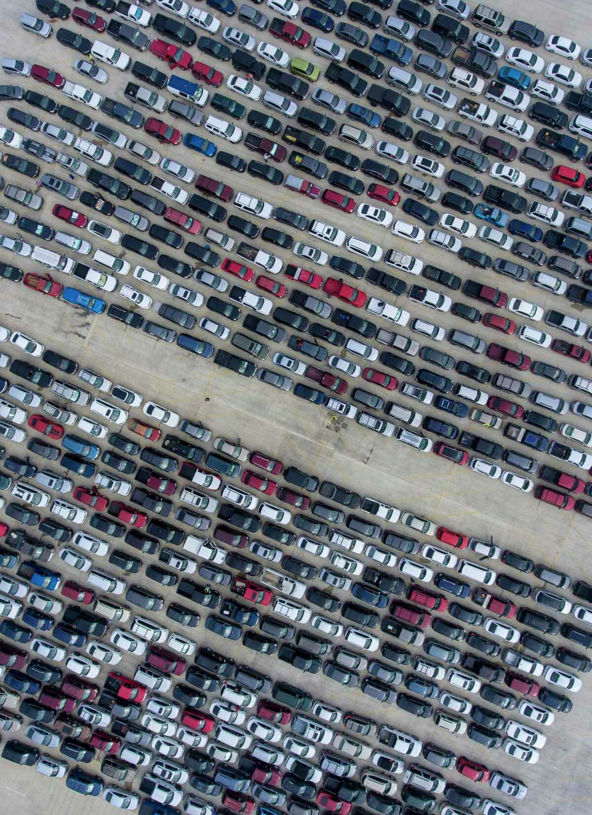 A mass of people wait in their cars at Traders Village for a San Antonio Food Bank distribution in April, early in the coronavirus pandemic.