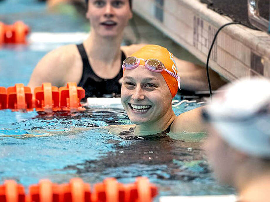 Tennessee's Bailey Grinter, center, a former Edwardsville High and Edwardsville Breakers swimmer, has been named to the College Swimming and Diving Coaches Association of America All-America team. Photo: Tennessee Volunteer Athletics