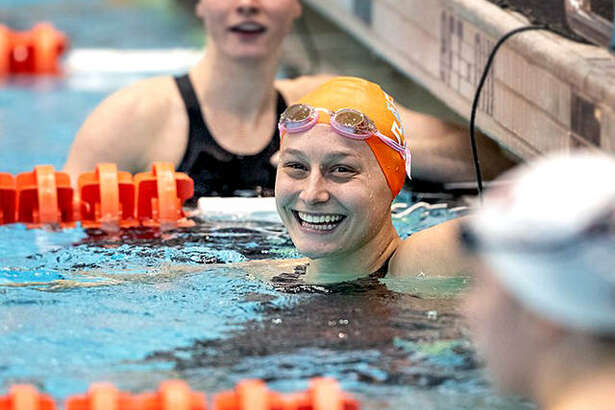 Tennessee's Bailey Grinter, center, a former Edwardsville High and Edwardsville Breakers swimmer, has been named to the College Swimming and Diving Coaches Association of America All-America team.