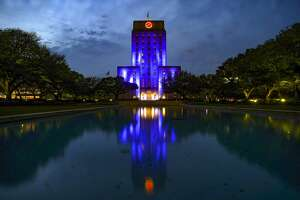 Houston's City Hall is lit blue for part of a nationwide #LightItBlue movement to honor essential workers on the front lines of the coronavirus pandemic on Thursday, April 9, 2020.