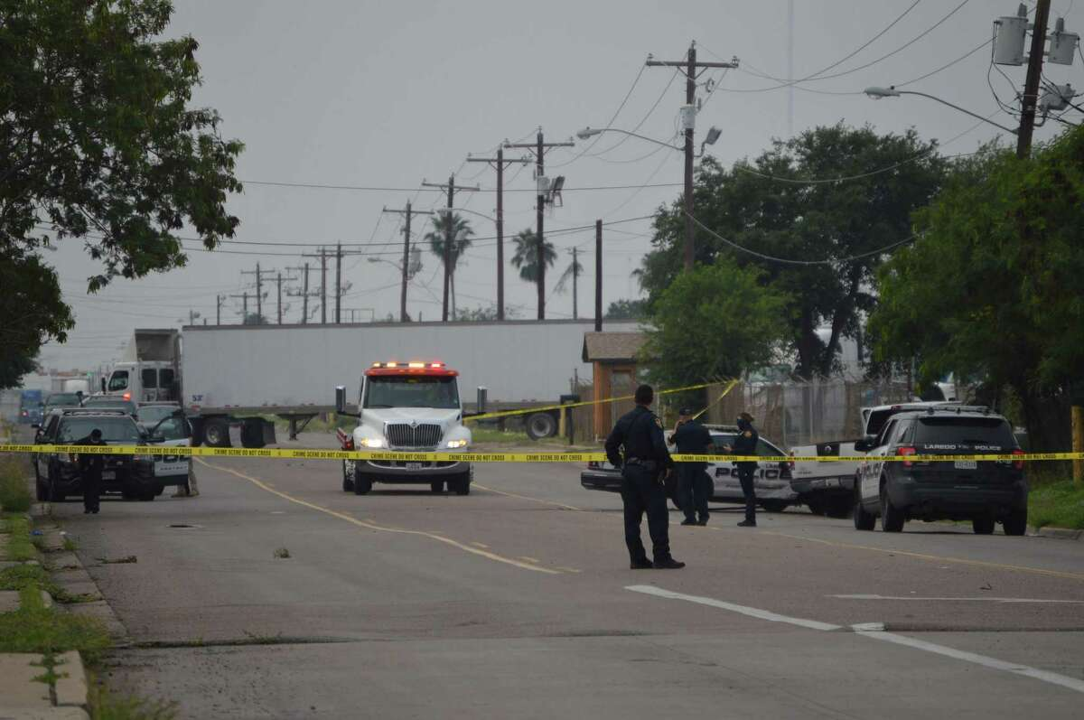 Laredo police officers are seen blocking the area where an alleged officer-related shooting occurred early Thursday in the 6500 block of Santa Maria Avenue.