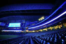 The Houston Astros' Minute Maid Park was lit blue to honor those working on the front line of the coronavirus pandemic on Thursday, April 9, 2020.