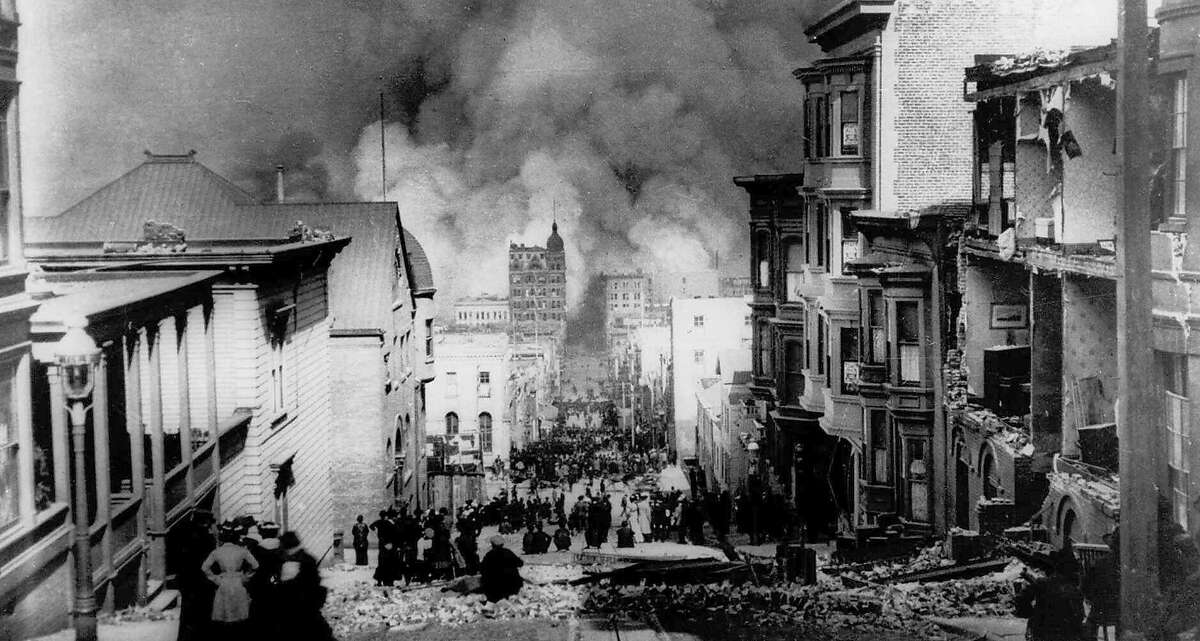 FILE--People watch smoke billowing from fires after a severe earthquake hit San Francisco April 18, 1906. Violent shocks punctuated the strong shaking which lasted some 45 to 60 seconds, and was felt from southern Oregon to south of Los Angeles and inland as far as central Nevada, with an epicenter near San Francisco. An estimated 700 people were killed. (AP Photo/Arnold Genthe)