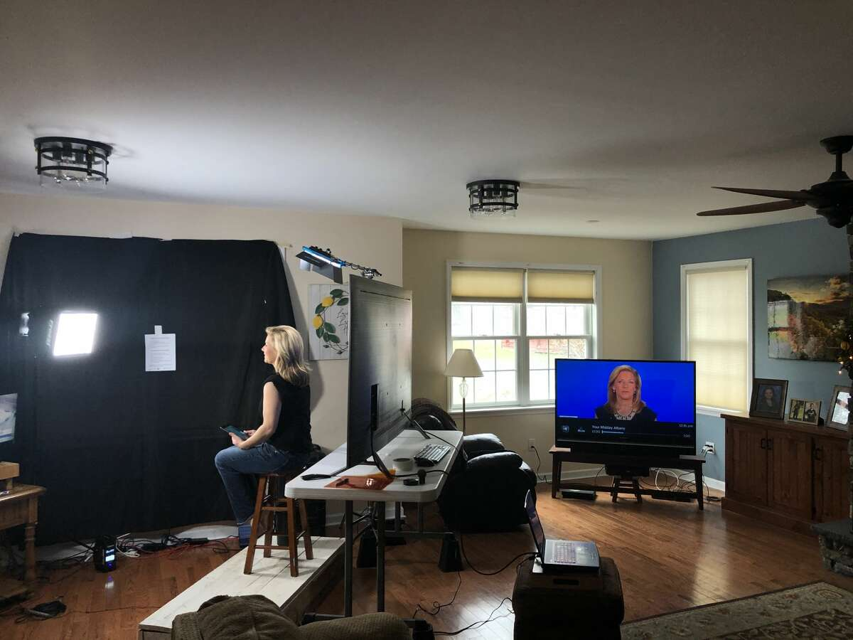 Spectrum News anchor Julie Chapman broadcasts live from home.