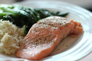 Marci Sharif and her husband demonstrate cooking salmon with a sous vide.
