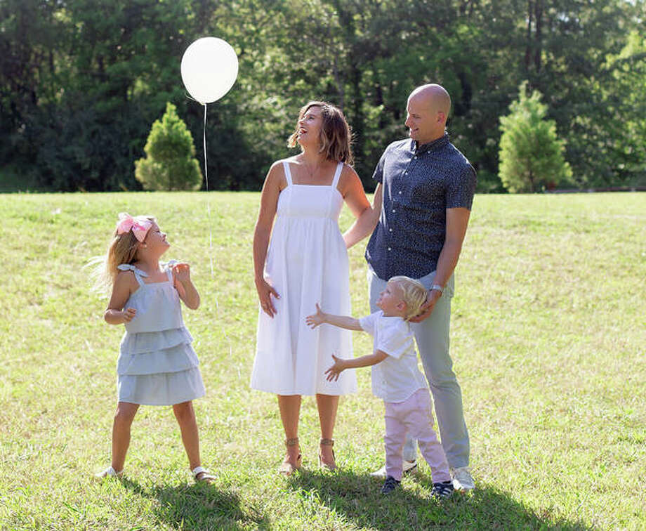 The Battas family — Beckett, left, mom Ashley, second to left, Brooks, second to right, and dad Dustin — let a balloon fly into the air in memory of Ben, who passed away on April 4, 2019, after a stillbirth.