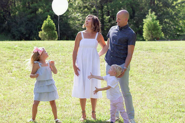 The Battas family - Beckett, left, mom Ashley, second to left, Brooks, second to right, and dad Dustin - let a balloon fly into the air in memory of Ben, who passed away on April 4, 2019, after a stillbirth.