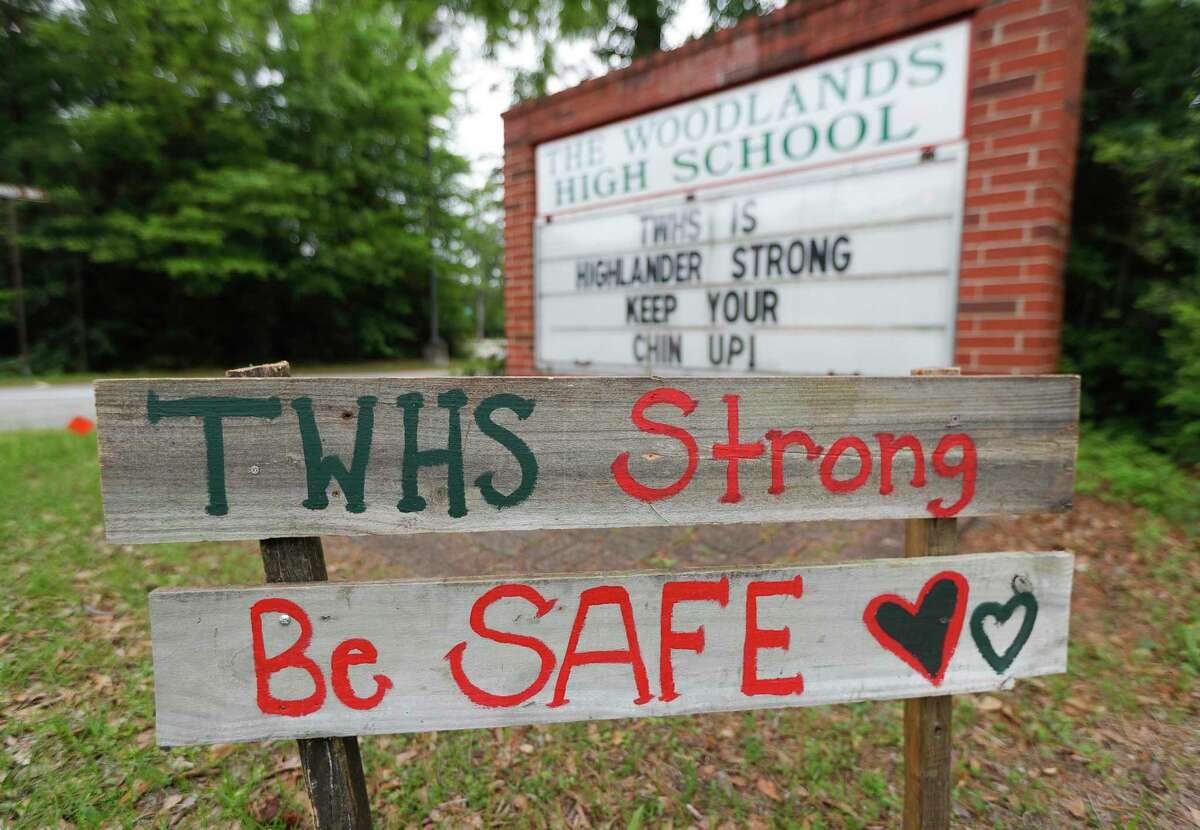 Signs of encouragement are seen at The Woodlands High School, Tuesday, March 31, 2020, in The Woodlands.