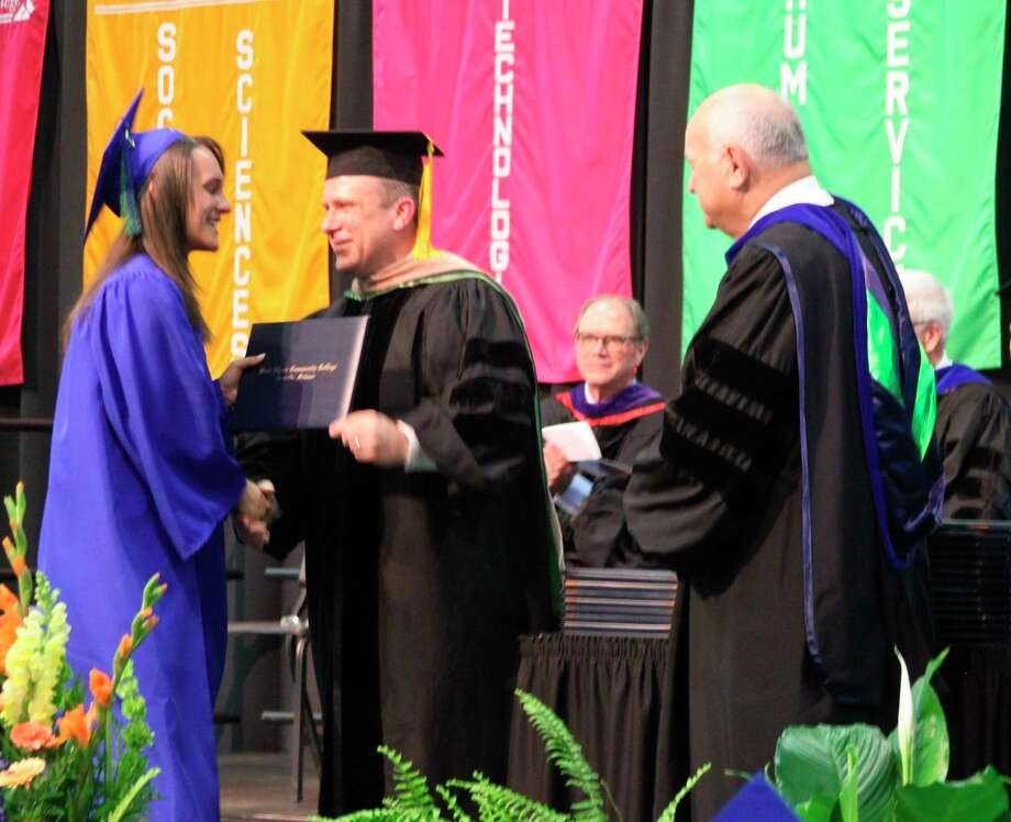 West Shore Community College president Scott Ward is shown presenting a diploma at the 2019 commencement exercises at the college as board of trustees chairman Bruce Smith looks on. College officials announced on Friday that the 2020 commencement has been postponed due to the coronavirus outbreak. The college is exploring options of holding a ceremony at a later date, but no decision has been made at this time. (File photo)