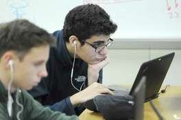 Pasadena ISD is spending $2.1 million to purchase over 7,000 Chromebook laptops, such as these used by students in Connecticut, for remote learning by third- and fourth-graders.