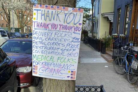 Residents of Park Slope in Brooklyn, N.Y., have posted thank you messages to essential workers who have continued to keep the city running.
