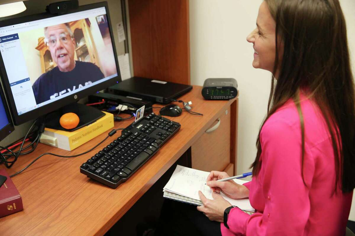 From his home in Fischer, Texas, Dwayne Portner, 56, talks with Kendra Keith, a clinical dietician with the South Texas Weight and Metabolic Disorder Treatment Center (WAMD) at Audie L. Murphy Memorial VA Hospital, during a telemedicine conference, Thursday, April 11, 2019. Portner has lost 136 pounds, since his bariatric surgery in 2017. The center aims to help veterans at risk with weight control through diet, exercise, mental health and social work assistance. Because they often suffer physical and mental disabilities, veterans are at special risk for obesity, diabetes and associated ailments. WAMD is a VA program that takes a whole-team approach to address these issues.