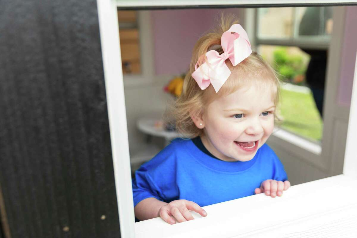 Leigh Ann Cribbs, age 3, now has the playhouse of her dreams through the Make-A-Wish Foundation.