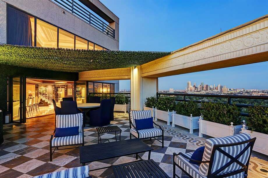 Located at 101 Westcott Street in Bayou Bend Towers, this $7 million penthouse offers four bedrooms, five full bathrooms and one half bathroom, dramatic main staircase, large custom closets and a 2,500-square-foot outdoor terrace with a private pool, bar and cabana. Photo: TK Images/Houston Association Of Realtors
