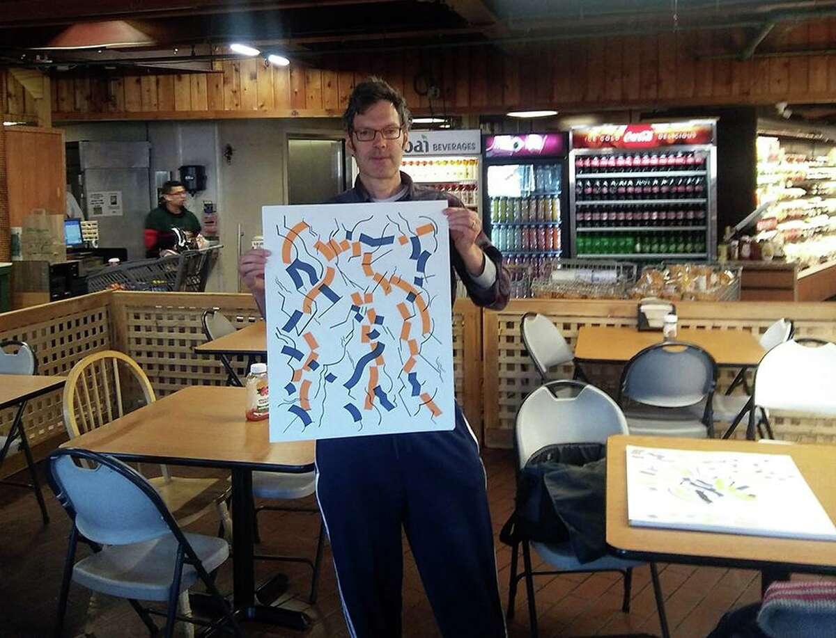 Bob Carley holds his abstract drawing at The Stew Leonard's in Norwalk.