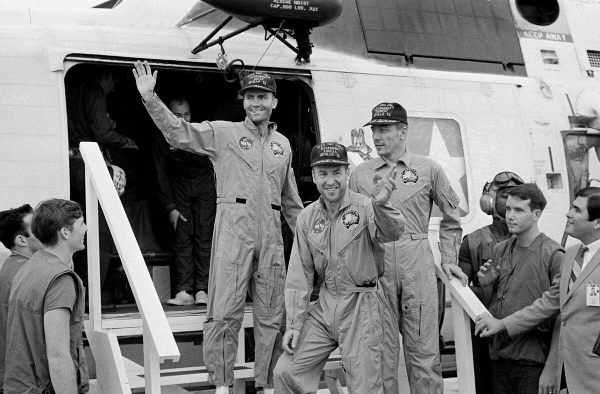 The crewmembers of the Apollo 13 mission, step aboard the USS Iwo Jima, prime recovery ship for the mission, following splashdown and recovery operations in the South Pacific Ocean. Exiting the helicopter which made the pick-up some four miles from the USS Iwo Jima are (from left) astronauts Fred W. Haise Jr., lunar module pilot; James A. Lovell Jr., commander; and John L. Swigert Jr., command module pilot. The crippled Apollo 13 spacecraft splashed down April 17, 1970.