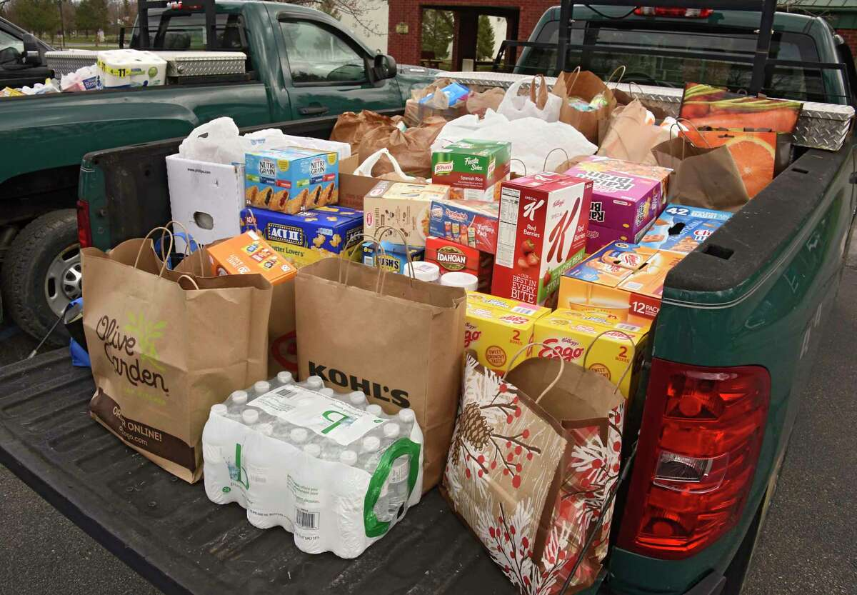 Donated food and supplies are seen loaded in a pick-up truck. (Lori Van Buren/Times Union)