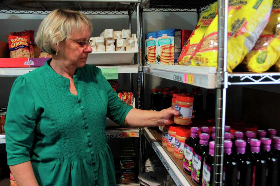 Manna Pantry Executive Director Bonnie Clark said the pantry is in need of more volunteers, as some of the older volunteers have opted to stay at home during recent coronavirus concerns. Those interested in volunteering may call the pantry at 231-408-2940. (Pioneer file photo)