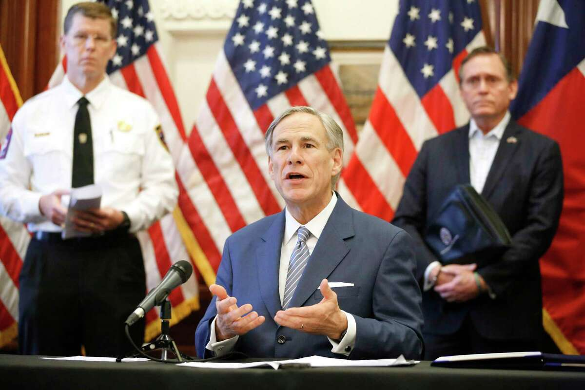 Texas Governor Greg Abbott announced the US Army Corps of Engineers and the state are putting up a 250-bed field hospital at the Kay Bailey Hutchison Convention Center in downtown Dallas during a press conference at the Texas State Capitol in Austin, Sunday, March 29, 2020. The space can expand to nearly 1,400 beds. Joining him are Texas Division of Emergency Management Chief Nim Kidd (left) and former State Representative Dr. John Zerwas (right). (Tom Fox/The Dallas Morning News/Pool)