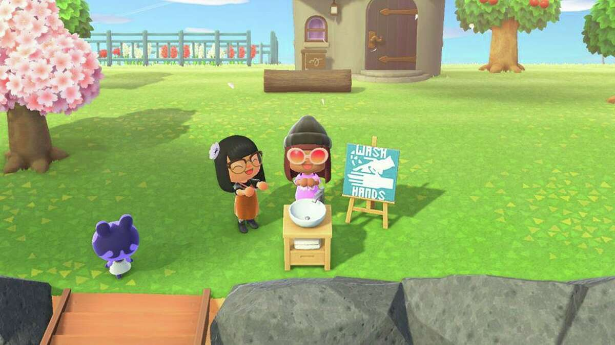 """Reporter Wei-Huan Chen's avatar, """"Maddi,"""" washes hands before visiting local Houston actor Mai Le's island in """"Animal Crossing."""""""