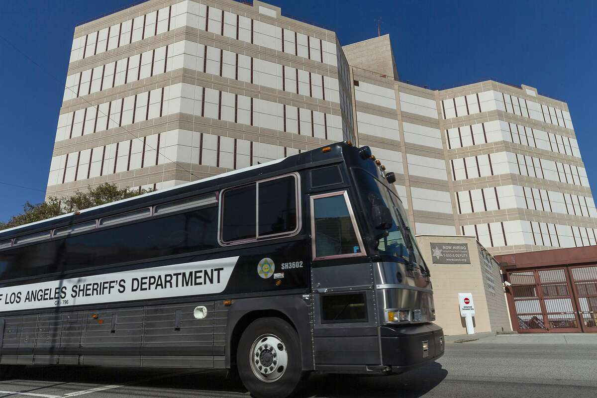 A Los Angeles County Sheriff's Department prisoner transportation bus leaves the Twin Towers Correctional Facility in Los Angeles on Wednesday, April 1, 2020. California is planning to release within days as many as 3,500 inmates who were due to be paroled in the next two months as it tries to free space in cramped prisons in anticipation of a coronavirus outbreak, state officials said Tuesday. (AP Photo/Damian Dovarganes)