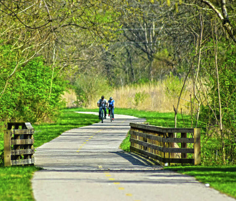 A couple of bicyclists are seen on the Glen Carbon Heritage Bike Trail on Wednesday afternoon when temperatures reached 90 degrees, breaking the record for the Greater St. Louis area. Photo: Tyler Pletsch | The Intelligencer