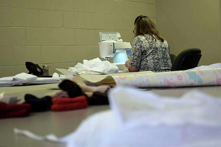 It is all hands on deck at the Tuscola County Medical Care Center, Caro, during the pandemic. Those who work at the facility's annex brought in their sewing machines to make isolation gowns for staff to help keep them and residents safe. (Courtesy Photo)