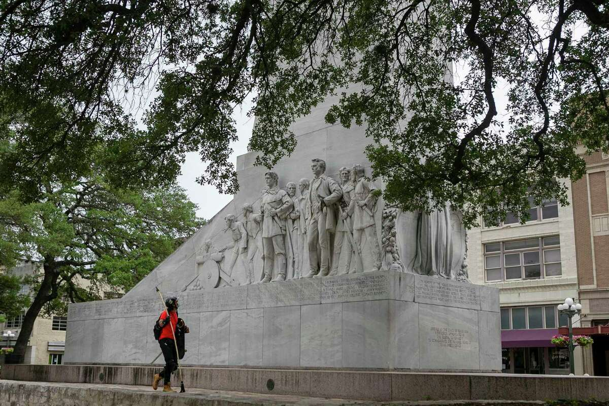 A man walks past the Cenotaph in Alamo Plaza in San Antonio, Texas as seen on April 9, 2020. Work on improvements to Alamo Plaza is continuing, despite the pandemic, and in the next few weeks. This is the $15 million first phase of a larger $450 million makeover of Alamo Plaza also includes utility relocation and planting of trees.