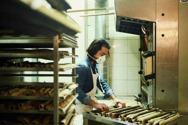 Florian Berthe, a 39-year-old baker, continues to work despite the covid-19 pandemic. Bakeries have been declared essential in France.