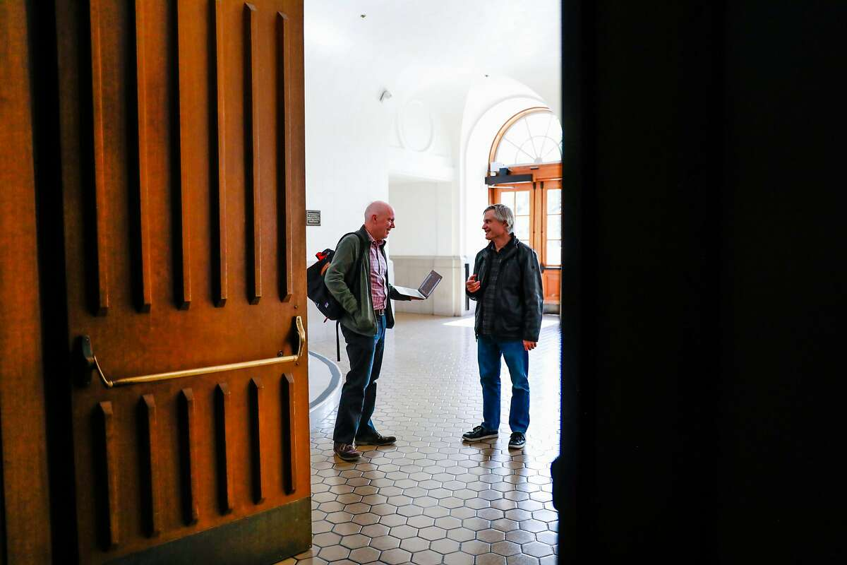 Jon Hays and Ezra Daly (right) who work in IT prepare to get classes up on the web so students can access them remotely at UC Berkeley on Tuesday, March 10, 2020 in Berkeley, California. UC Berkeley has suspended in-person classes through the end of Spring break due to the coronavirus.