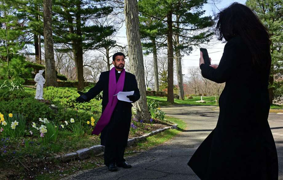 Fr. Sunil Pereira and staff at St. Matthew's Church perform and live stream the Stations of the Cross on Good Friday, April 9, 2020, in the outdoor grotto at the church in Norwalk, Conn. Photo: Erik Trautmann / Hearst Connecticut Media / Norwalk Hour