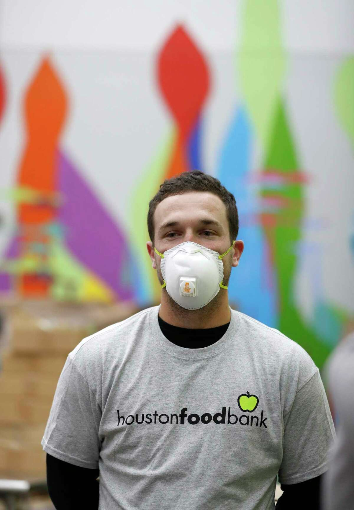 Houston Astros Alex Bregman conducts an interview before volunteering with his fiancee, Reagan Howard, at the Houston Food Bank, in Houston,Friday, April 10, 2020. Bregman launched his FEEDHOU, a $1 million fundraising campaign to help feed Houston-area residents during the coronavirus pandemic.