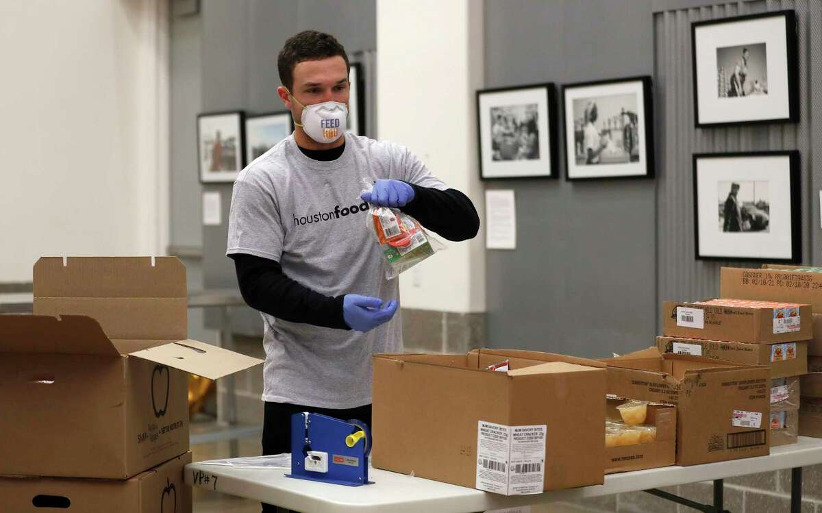 Houston Astros Alex Bregman packaging sustainable kids meals at the Houston Food Bank, in Houston,Friday, April 10, 2020. Bregman launched his FEEDHOU, a $1 million fundraising campaign to help feed Houston-area residents during the coronavirus pandemic.