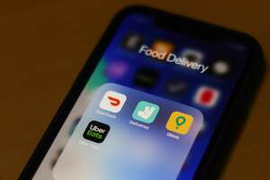 DoorDash, Deliveroo, Glovo and Uber Eats apps icons are seen on the smartphone screen in this illustration photo taken in Krakow, Poland on March 17, 2020. (Photo by Jakub Porzycki/NurPhoto via Getty Images)