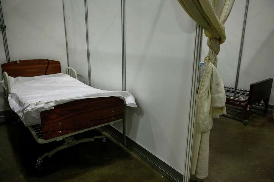 Beds line the main floor of the converted TCF Center in Detroit. The 1,000-bed field hospital accepted its first patients Friday. (Jacob Hamilton/MLive.com via TNS) / mlive.com