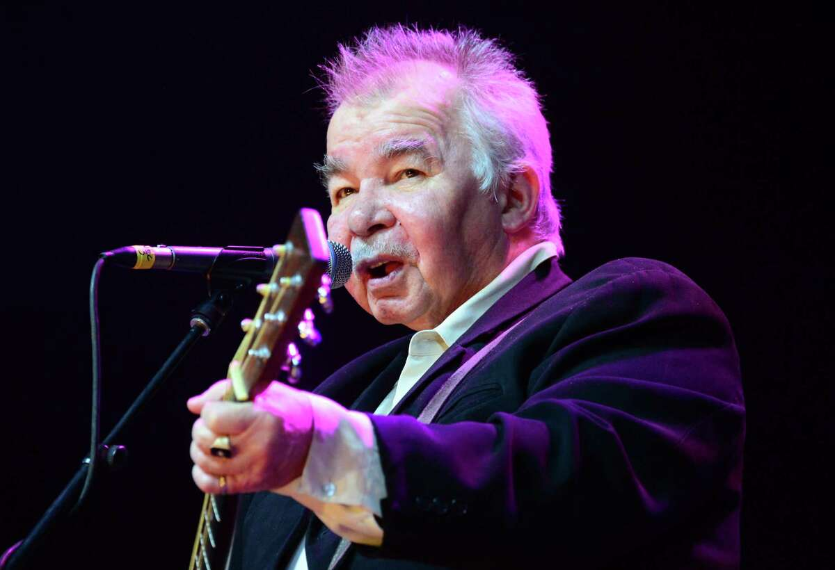 """Singer-songwriter John Prine came across as a """"regular guy,"""" but his songwriting was exceptional. He'd beaten squamous cell cancer, throat cancer and lung cancer - but COVID-19 was too much."""