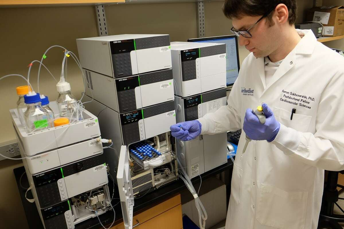 Dr. Roman Sukhovershin tests the integrity of the RNA vaccine at Houston Methodist Hospital. The Methodist team is led by Dr. John Cooke who is now collaborating with Woodlands-based VGXI to develop a COVID-19 vaccine.