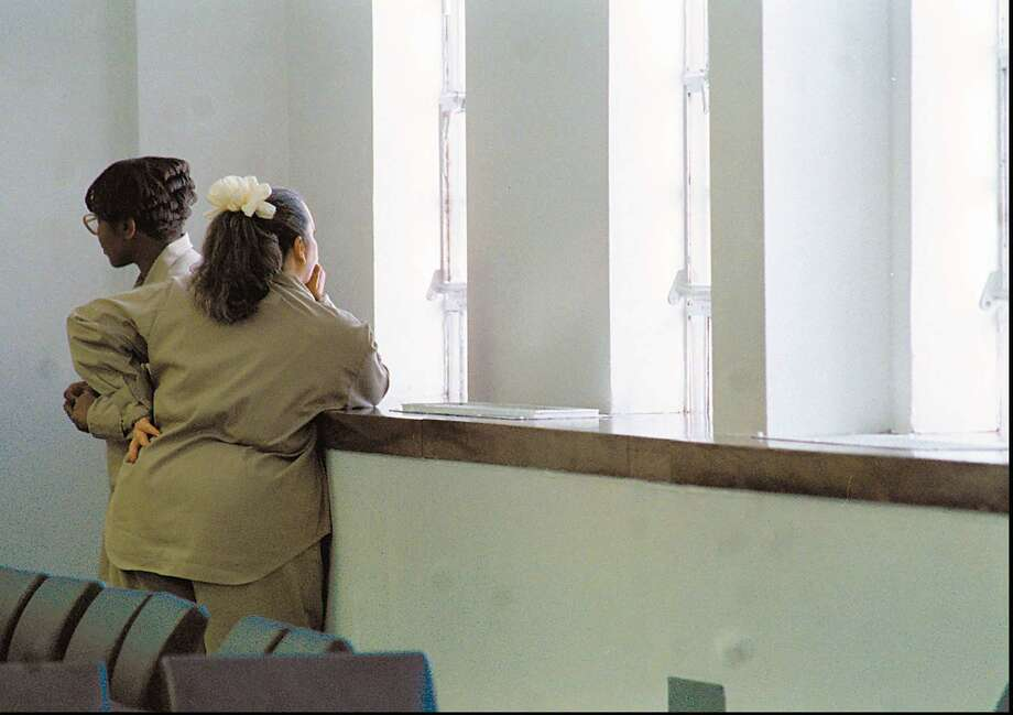 Inmates look out of the window after the conclusion of a visit from the Prisoner Visitation and Support group at a prison. Photo: File Photo