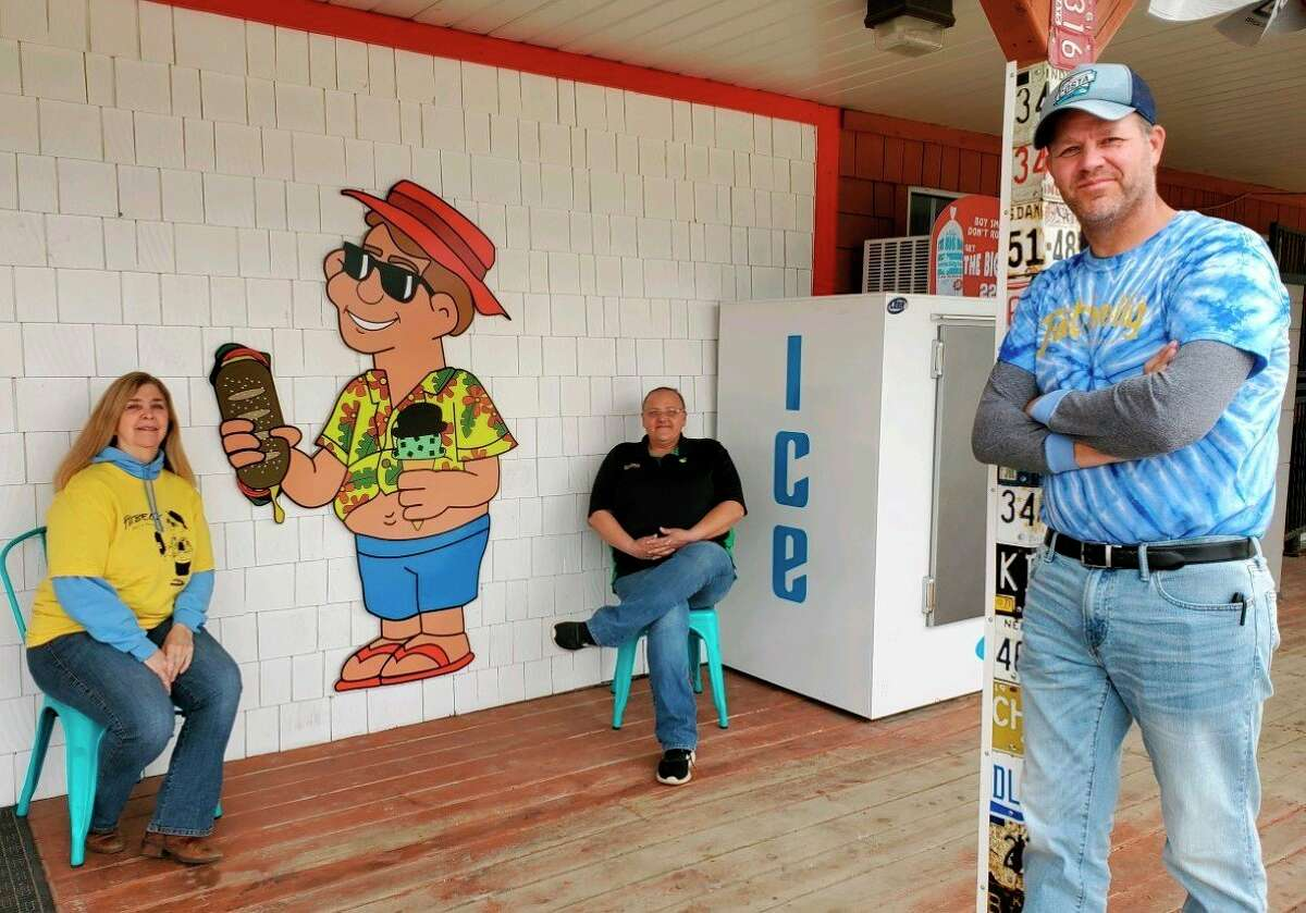 """Victoria Butler (left), owner of the Davis Bridge General Store and Fatbelly Deli and Creamery, Shawn Benson (middle), manager at Davis Bridge General Store, and Jake Bulter (right), manager at Fatbelly, are among the many """"essential workers"""" who are trying to support the community in a time of fear and uncertainty. (Courtesy photo)"""