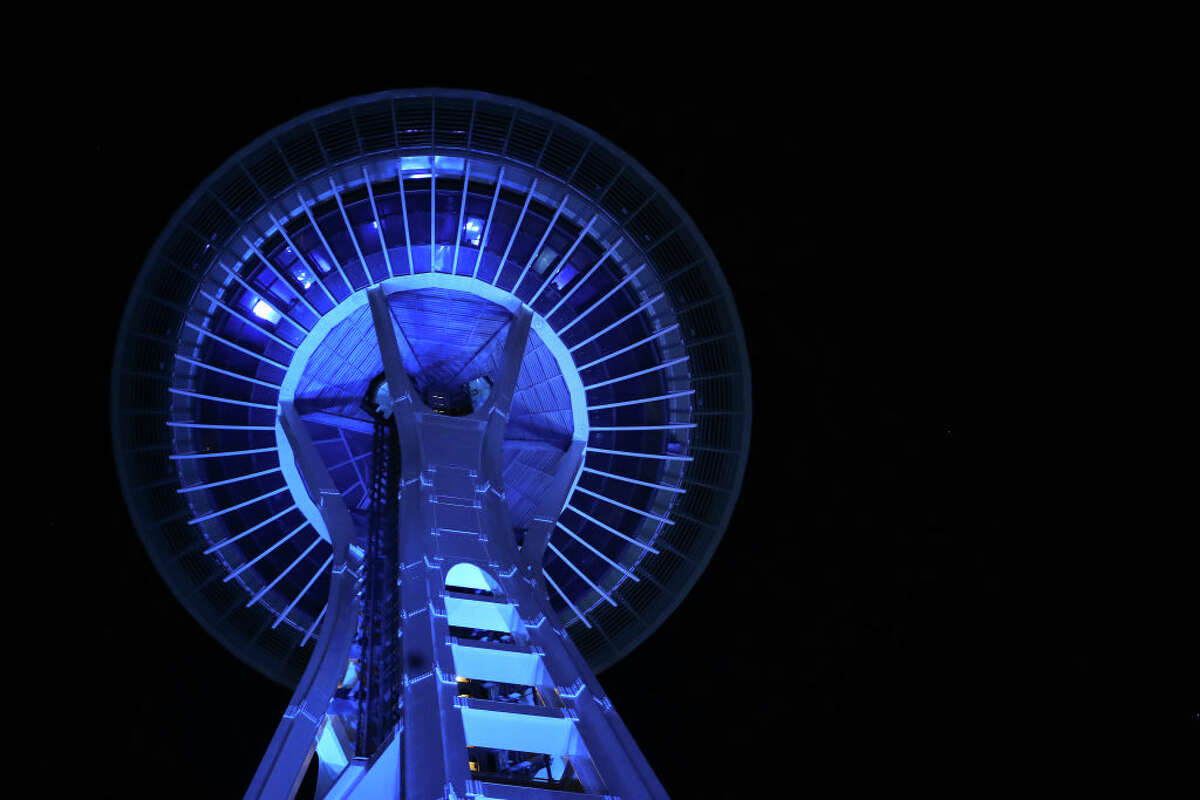 SEATTLE, WA - APRIL 9: A general view of the Space Needle lit up in blue to honor essential workers during the coronavirus (COVID-19) outbreak on April 09, 2020 in Seattle, Washington. Landmarks and buildings across the nation are displaying blue lights to show support for health care workers and first responders on the front lines of the COVID-19 pandemic. (Photo by Abbie Parr/Getty Images)