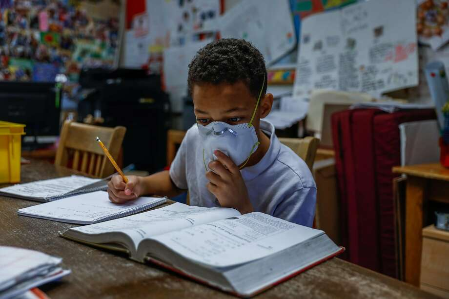 Joshua Owens ,12, does schoolwork at WHAP Scholastic Academy during the Covid-19 shelter-in-place order in Marin City, California on Tuesday, March 31, 2020. Photo: Gabrielle Lurie / The Chronicle