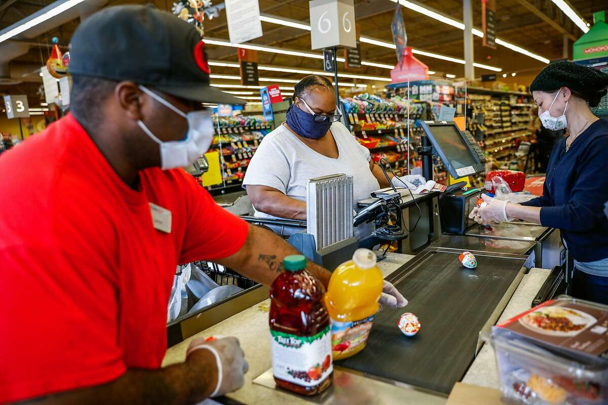Customers check out at a Safeway in Mill Valley on March 31, 2020.