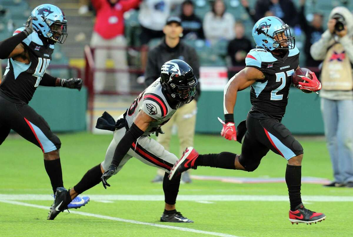 Austin Walter #27 of the Dallas Renegades outruns Demetrious Cox #36 of the NY Guardians on a 97 yard return for a touchdown at an XFL football game on March 7, 2020 in Arlington, Texas. The league announced on Thursday, Oct. 1, 2020 that it plans to return in 2022. Its 2020 comeback season was cut short by the coronavirus crisis, and the Vince McMahon-founded league then filed for bankruptcy.