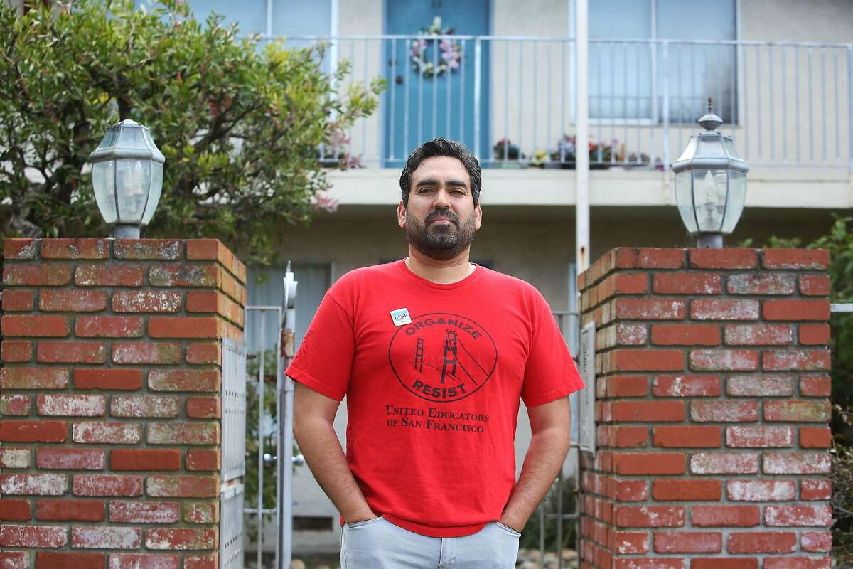 Frank Lara, fifth grade bilingual teacher at Buena Vista Horace Mann and member of United Educators of San Francisco, stands for a portrait outside his home on Friday, April 10, 2020 in South San Francisco, Calif.