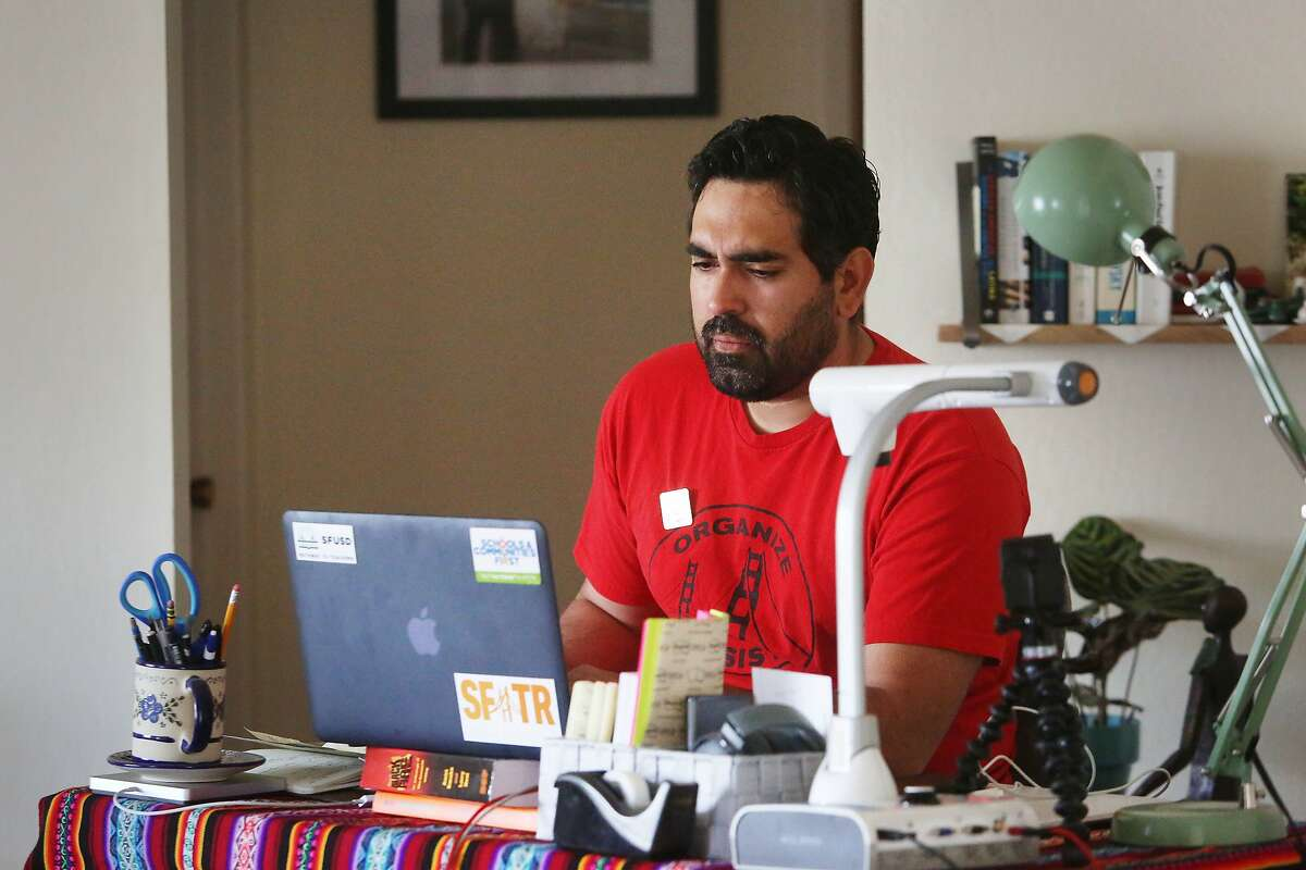 Frank Lara, fifth grade bilingual teacher at Buena Vista Horace Mann and member of United Educators of San Francisco, works at a desk that he set up at his home after the the coronavirus shelter in place on Friday, April 10, 2020 in South San Francisco, Calif.
